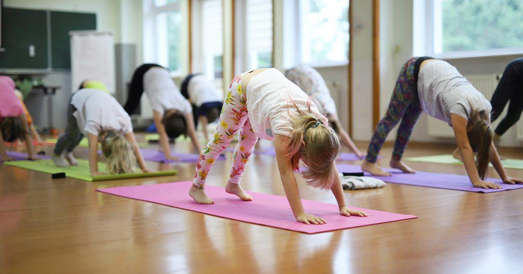 kids doing yoga; blog: health benefits of yoga for kids
