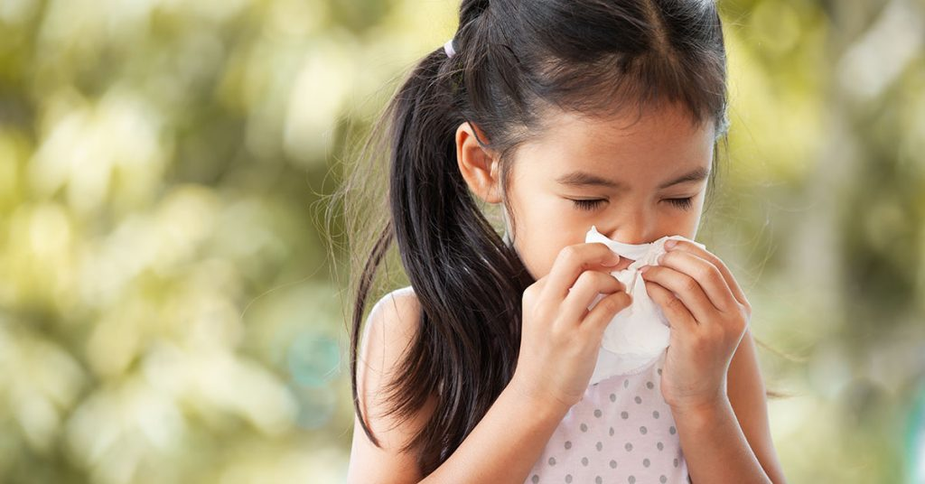 Sick asian little child girl wiping and cleaning nose with tissue on her hand; Tips for Managing Seasonal Allergies